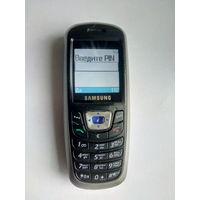"""Мобильный телефон """"SAMSUNG SGH-C210"""" + подзарядное устройство."""