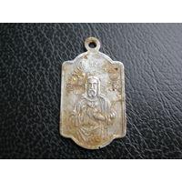Католический медальон.