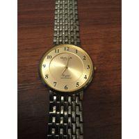 Старые кварцевые часы omax