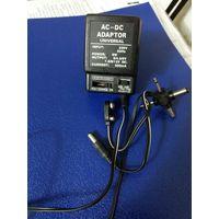 Универсальное зарядное устройство (AC-DC Adaptor). С переключателем напряжения! Для старых образцов разъемов (для нокий, сименсов и т.п.)