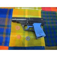 Детский игрушечный пистолет стреляющий дисками