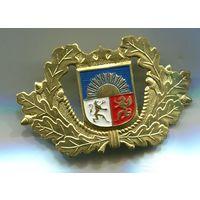 Кокарда полиции безопасности Латвии