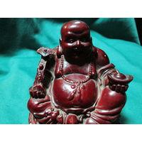Статуэтка Будда .