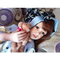 Кукла фарфоровая.