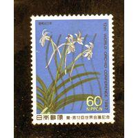 Япония. Ми - 1728. 12 международная конференция по орхидеям.Цвкты. 1987.