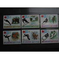 Марки - фауна, Либерия, птицы, звери, дятел, журавль, медведь, олень и др. - спорт, зимние виды