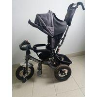 Детский трёхколёсный велосипед-коляска