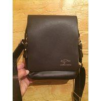 Мужская сумка коричневого цвета в хорошем состоянии. Размер сумки 23 на 18 см, ширина 7 см, есть длинная ручка, много отделов, удобная и красивая. Б/у недолго, в хорошем состоянии.