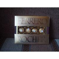 Конфеты ''Ферреро'' в подарочной упаковке 125 граммов.
