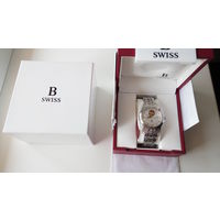 Швейцарские механические часы фирмы Carl F. Bucherer с позолоченным механизмом, стрелки из золота. Сапфир. Автоподзавод. Новые.