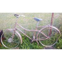 """Старый велосипед или мопед """"Рига""""."""