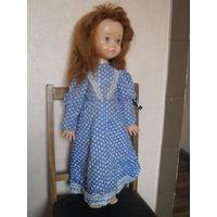 Кукла большая (рост 70 см.) руки,ноги на резинках.Ходит,вращает головой.