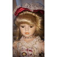 Куколка винтажная фарфоровая. 40 см.