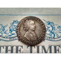 Монета РИ, 1 рубль 1704 (дата чеканки указана старославянскими буквами).