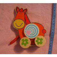 Деревянная лошадка-каталка