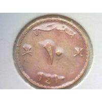 Оман 10 байз 1990 в холдере