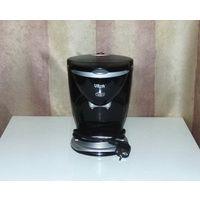Капельная кофеварка Vitek VT-1503 BK (чёрный цвет). Объём кофейника: 0.2 литра. Максимальная мощность: 450W. Длина кабеля: 60см.