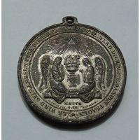 Старинная медаль.