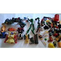 Роботы трансформеры и всякие запчасти лотом