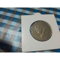 1 шиллинг 1949 года Восточной Африки в холдере 31